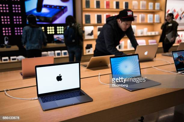 Apple Inc MacBook Pro laptop computers sit on display at the company's Williamsburg store in the Brooklyn borough of New York US on Friday May 20...