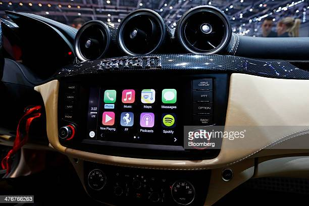 Apple Inc's CarPlay system is seen in the touchscreen console of a Ferrari FF automobile produced by Ferrari SpA as it stands on display at the...