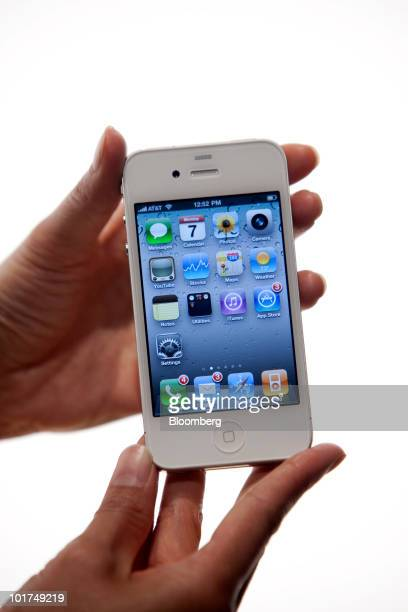 Apple Inc's iPhone 4 is held for a photo at the Apple Worldwide Developers Conference in San Francisco California US on Monday June 7 2010 Apple...