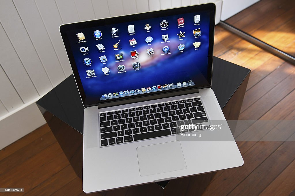 Apple Inc.'s new MacBook Pro, with retina display, is arranged for a photograph in San Francisco, California, U.S., on Monday, June 11, 2012. Apple is releasing a fresh lineup of computers and software tools to woo consumers and keep developers making applications amid accelerating rivalry from Google Inc., Microsoft Corp. and, now, Facebook Inc. Photographer: David Paul Morris/Bloomberg via Getty Images