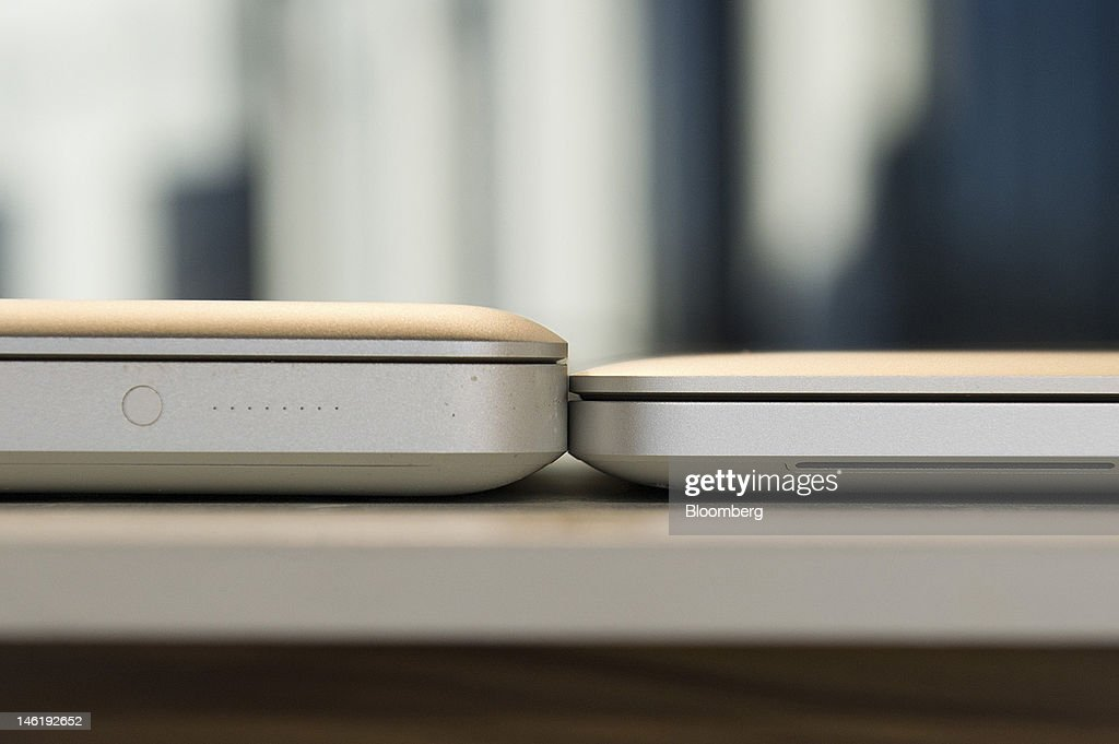 Apple Inc.'s new MacBook Pro, with retina display, right, and an older version of the MacBook Pro are arranged for a photograph in San Francisco, California, U.S., on Monday, June 11, 2012. Apple is releasing a fresh lineup of computers and software tools to woo consumers and keep developers making applications amid accelerating rivalry from Google Inc., Microsoft Corp. and, now, Facebook Inc. Photographer: David Paul Morris/Bloomberg via Getty Images