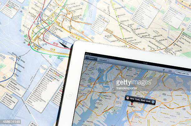 apple ipad 2 with new york city maps - google stock photos and pictures