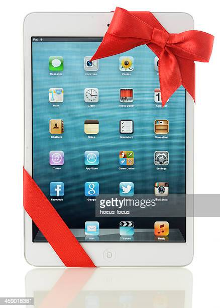 apple ipad mini gift - gift icon stock photos and pictures