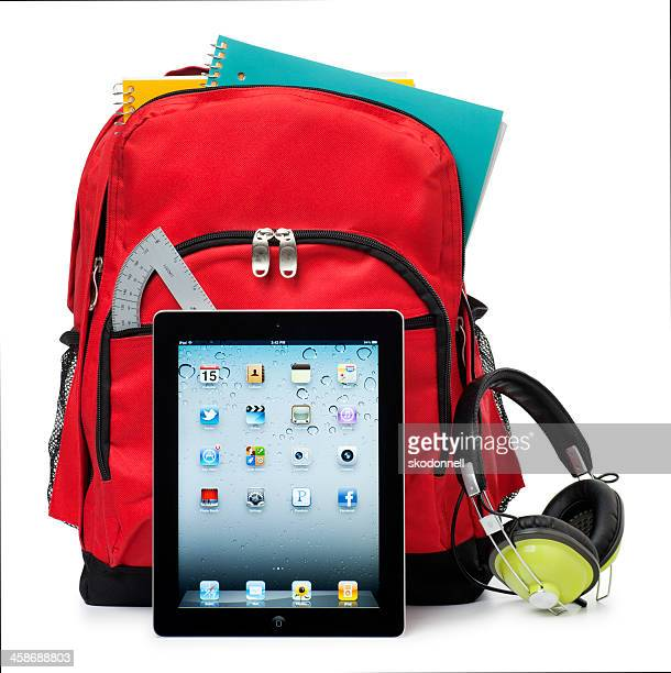 Apple iPad on White with a School Backpack