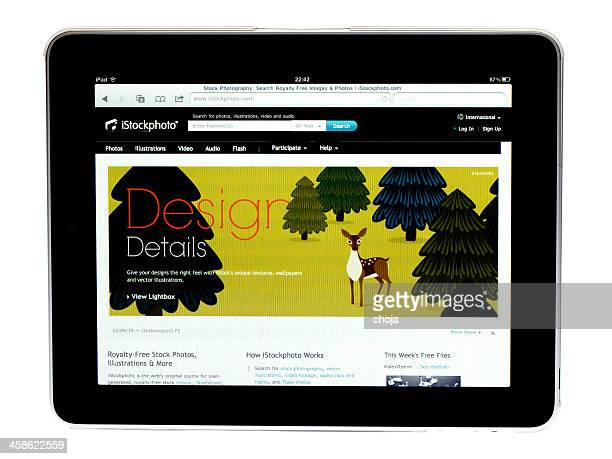apple ipad tablet ..picture of istockphoto site on screen - istock_photo stock pictures, royalty-free photos & images