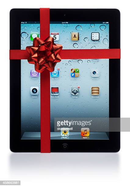 apple ipad with red bow - gift icon stock photos and pictures