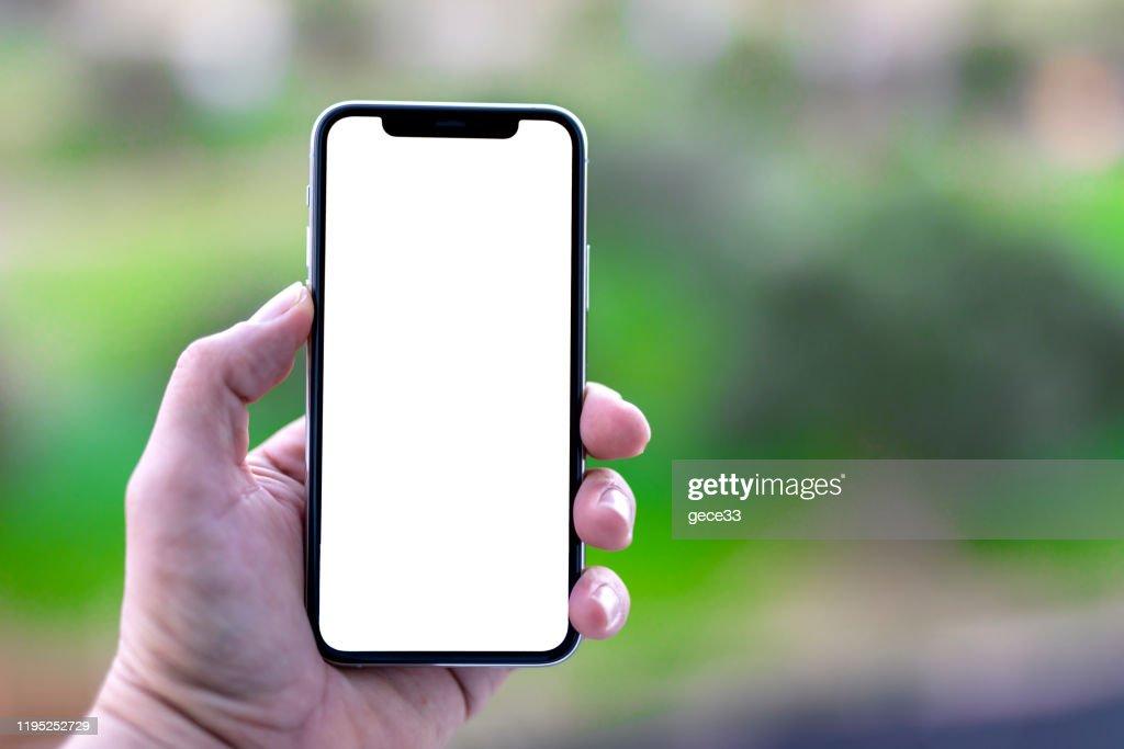 アップルのiPhone 11proシルバーホワイトホワイトスクリーン : ストックフォト
