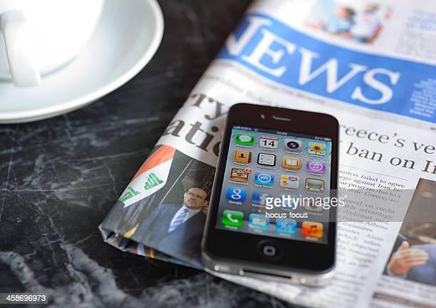 Apple iPhone 4 on coffee table