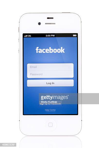 apple iphone 4s white with facebook - log on stock photos and pictures