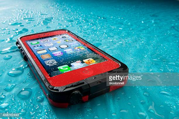 apple iphone 5 in lifeproof case - phone cover stock pictures, royalty-free photos & images