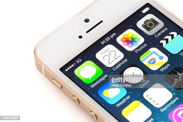 apple iphone 5s gold with home screen - calendar icon stock photos and pictures