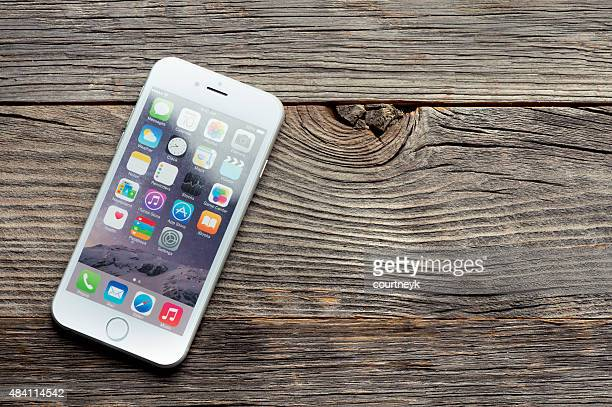 Apple iphone 6 on a wooden table or surface.