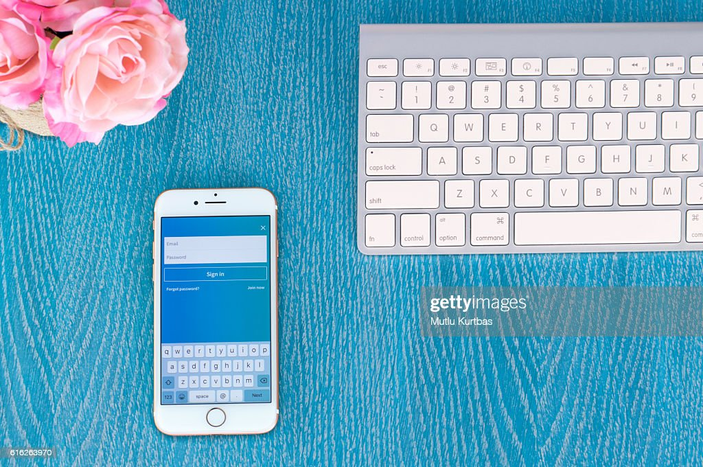Apple iPhone 7 Gold Rose on the table : Stock Photo