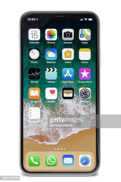 apple iphone x silver home screen - smartphone stock pictures, royalty-free photos & images