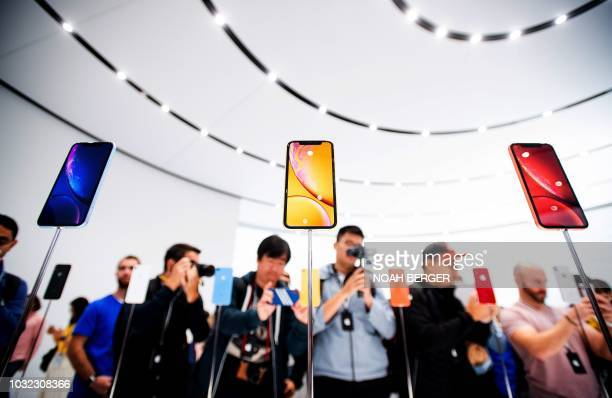 Apple iPhone Xr models rest on display during a launch event on September 12 in Cupertino California New iPhones set to be unveiled Wednesday offer...