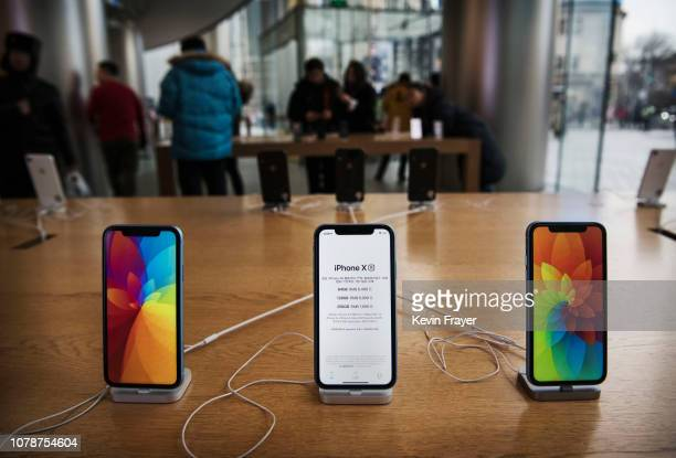 Apple iPhones are seen on display at an Apple Store on January 7 2019 in Beijing China Apple Inc lowered its revenue guidance last week blaming...