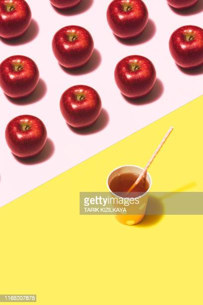 apple juice flat lay on yellow and pink background - colour block stock pictures, royalty-free photos & images