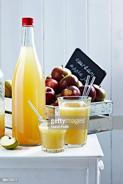 apple juice on table in bottles and glassses
