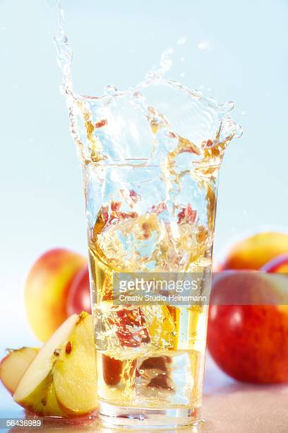 Apples and apple juice on table