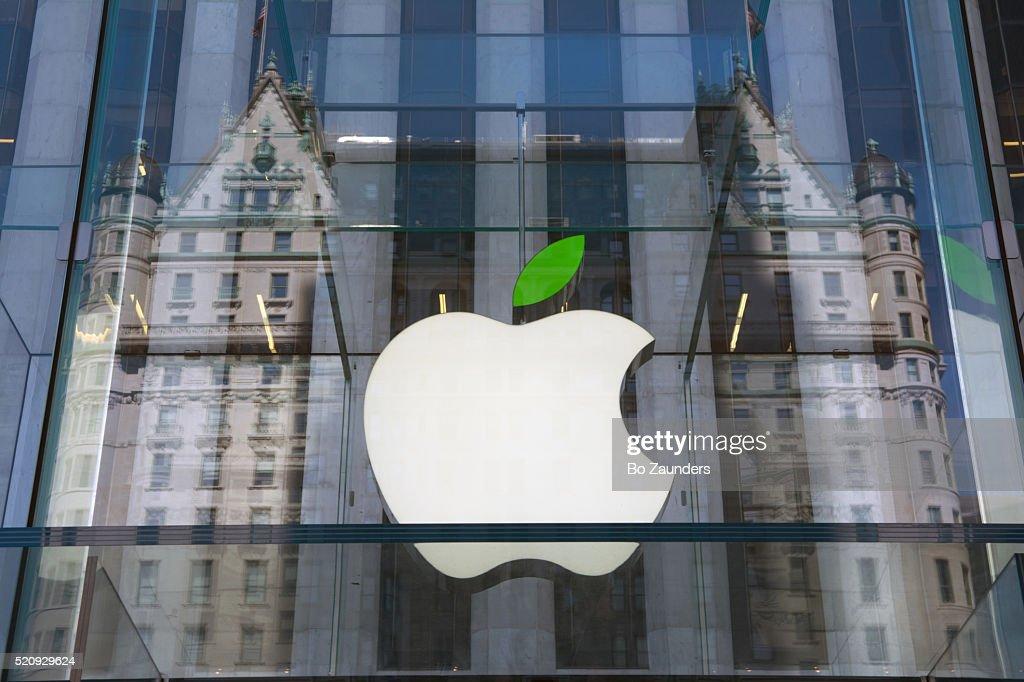 Apple logo and the Plaza Hotel : Stock Photo