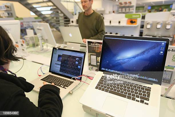 Apple MacBook Pro computers with Retina displays stand at a table at a Gravis Apple retailer on November 6 2012 in Berlin Germany Apple is hoping for...