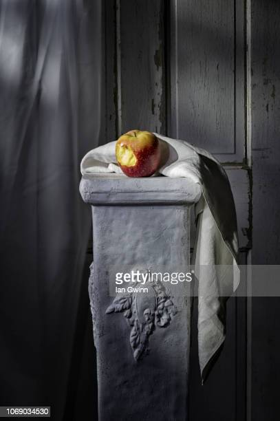 apple on pedestal - ian gwinn stock photos and pictures
