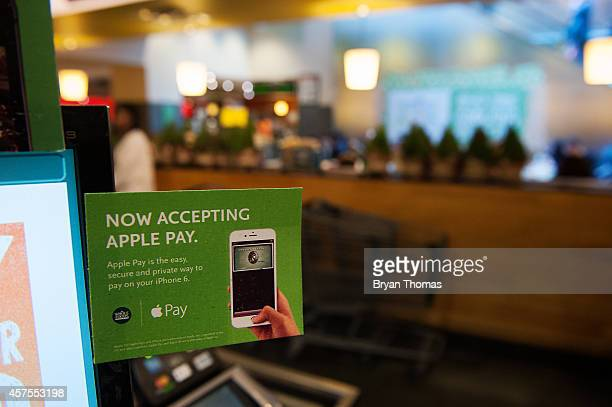 Apple Pay is promoted on signs placed at the cash register of Whole Foods in Columbus Circle on October 20 2014 in New York NY The software which...