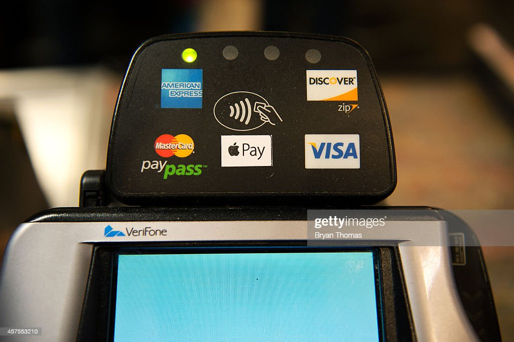 Apple Pay is promoted on signs placed at the cash register of Whole Foods in Columbus Circle on October 20, 2014 in New York, NY. The software, which debuted today, is available in the recently updated iPhone 6 software and accepted in 220,000 stores. It allows iPhone users to pay for purchases using their iPhone's NFC capabilities instead of using their credit card.
