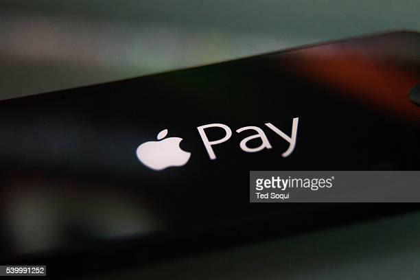 Apple Pay logo on a iPhone Apple Pay is the new digital wallet from Apple Credit card payments will be made with the iPhone instead of a card