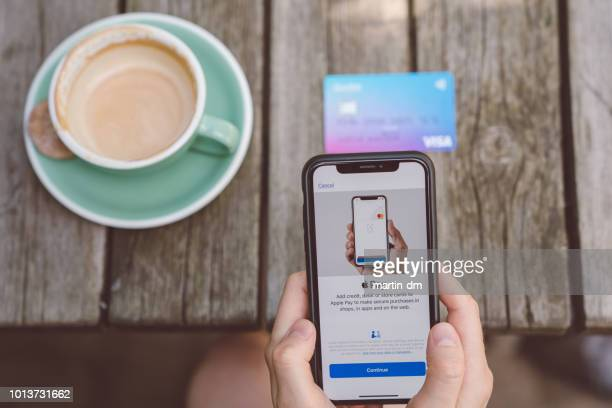 apple pay - apple pay mobile payment stock pictures, royalty-free photos & images