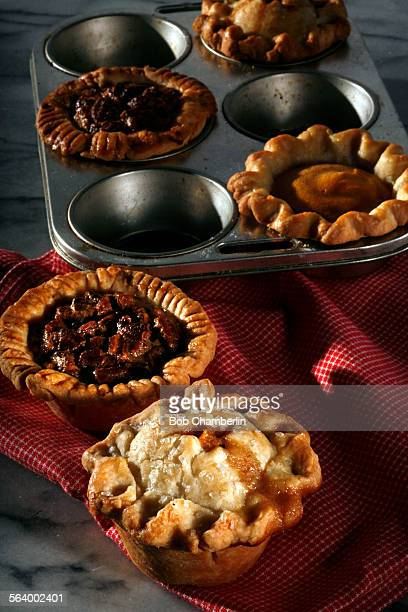 Apple pecan and pumpkin mini pies front to back on NOVEMBER 07 2012