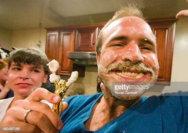 CONTENT] Apple pie eating contest winner holding his trophy Apple pie eating contests are an American tradition The contestants must eat an entire...