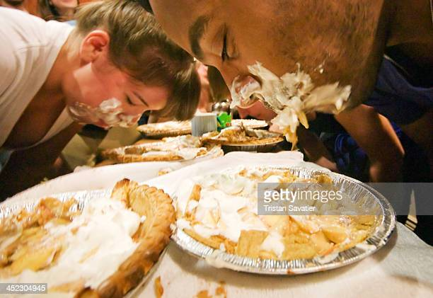 Apple pie eating contests are an American tradition. The contestants must eat an entire apple pie as fast as possible, without using their hands....