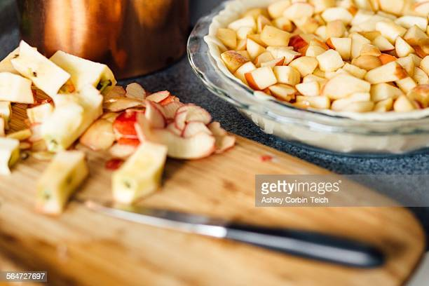 Apple pie preparation with chopped apples in raw pastry
