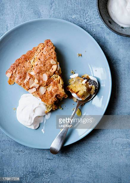 Apple pie with almond flakes and creme fraiche