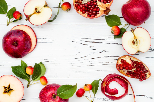 Apple, pomegranate and honey, traditional food of jewish New Year - Rosh Hashana. Copy space background 828515800