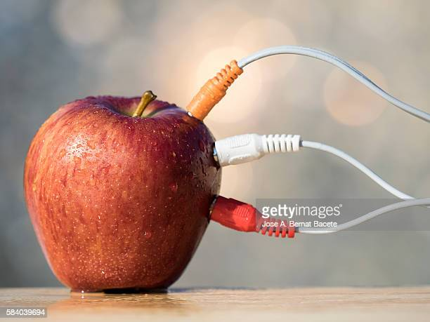Apple red with electrical wires connected