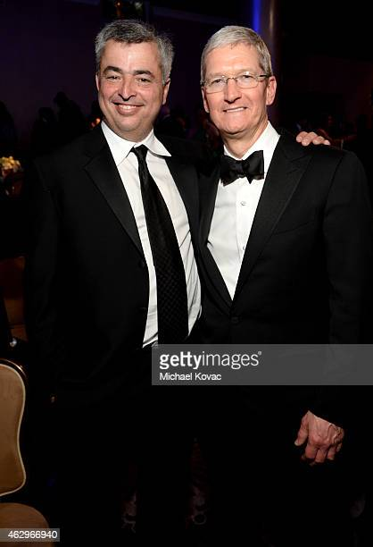Apple Senior Vice President of Internet Software and Services Eddy Cue and Apple CEO Tim Cook attend the PreGRAMMY Gala and Salute to Industry Icons...