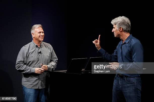 Apple Senior Vice President of Software Engineering Craig Federighi gestures to Vice President of Worldwide Marketing Phil Schiller during a product...