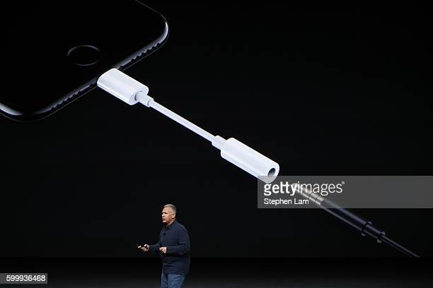 Apple Senior Vice President of Worldwide Marketing Phil Schiller introduces a Lightning to 35 mm audio jack adapter during a launch event on...