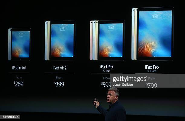 Apple senior vice president of worldwide marketing Phil Schiller shows the new 97 iPad Pro during an Apple special event at the Apple headquarters on...