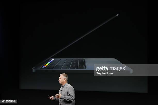 Apple Senior Vice President of Worldwide Marketing Phil Schiller introduces the allnew MacBook Pro during a product launch event on October 27 2016...