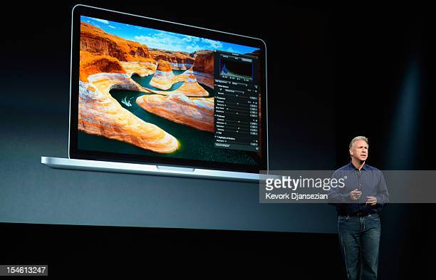 Apple Senior Vice President of Worldwide product marketing Phil Schiller announces the new 13inch MacBook Pro during an Apple special event at the...
