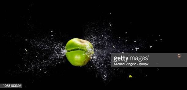 apple shot by bullet - bullet stock pictures, royalty-free photos & images