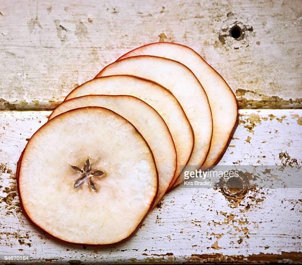 Apple slices on aged wood