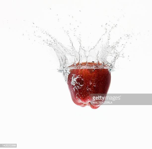 Apple splashing in water