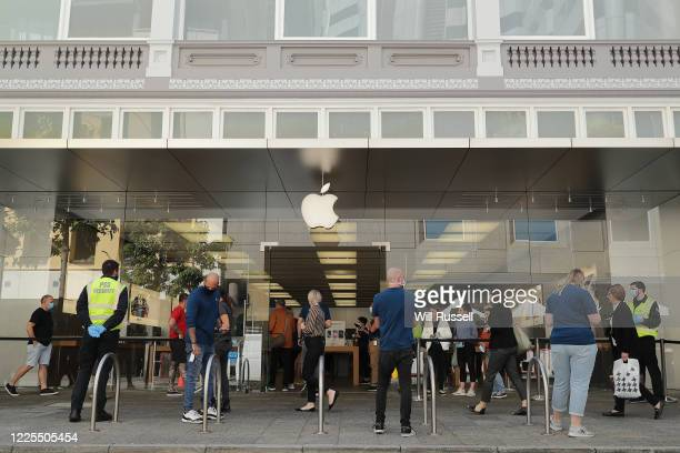 Apple staff ask health questions of people entering the Apple store in Perth's CBD on May 18, 2020. COVID-19 restrictions have further eased across...