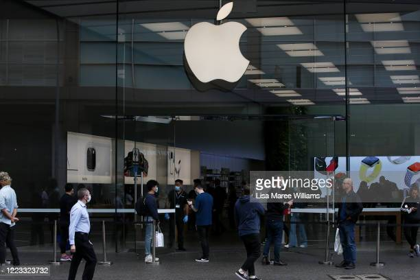 Apple staff members assist customers on the street prior to entering the Bondi Junction store on May 07, 2020 in Sydney, Australia. Apple stores...