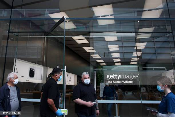 Apple staff members prepare to open the doors to customers at the Bondi Junction Apple Store on May 07, 2020 in Sydney, Australia. Apple stores...