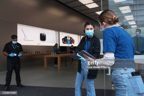 Apple staff members prepare to welcome customers when entering the Bondi Junction store on May 07, 2020 in Sydney, Australia. Apple stores across...